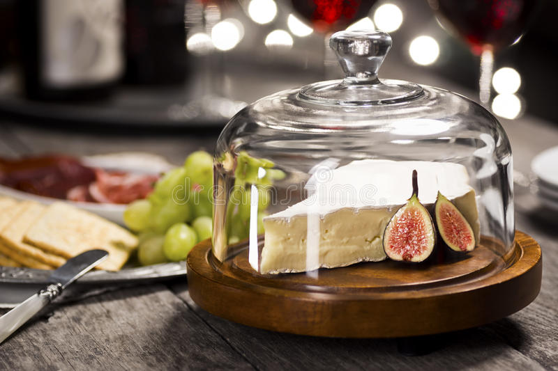 Brie Cheese and Wine for New Years Eve royalty free stock image