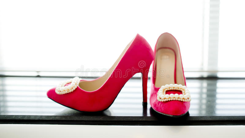 Bried shoes against the window. Shoe sofas studio style wedding wedlock white groom's bridal royalty free stock images