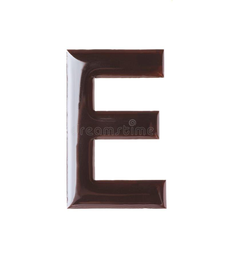 Brief E van chocolade wordt gemaakt die stock foto's