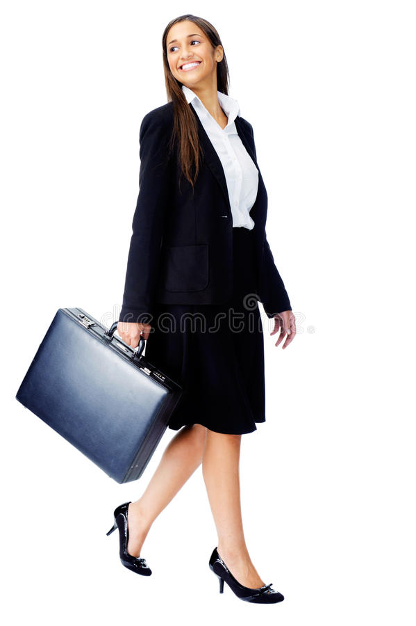 Briefcase business woman. Businesswoman wearing suit walking with briefcase isolated on white background stock image