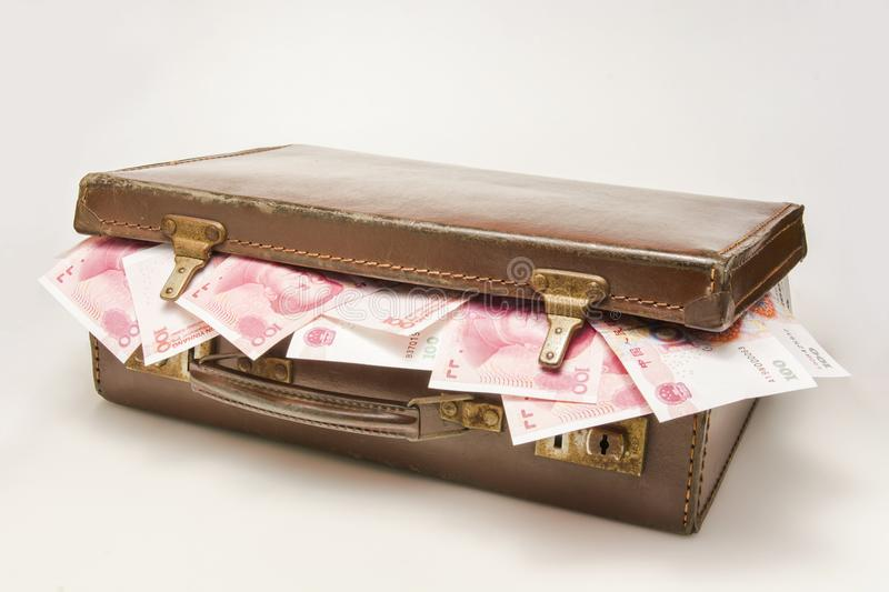 The briefcase filled with China RMB stock photos