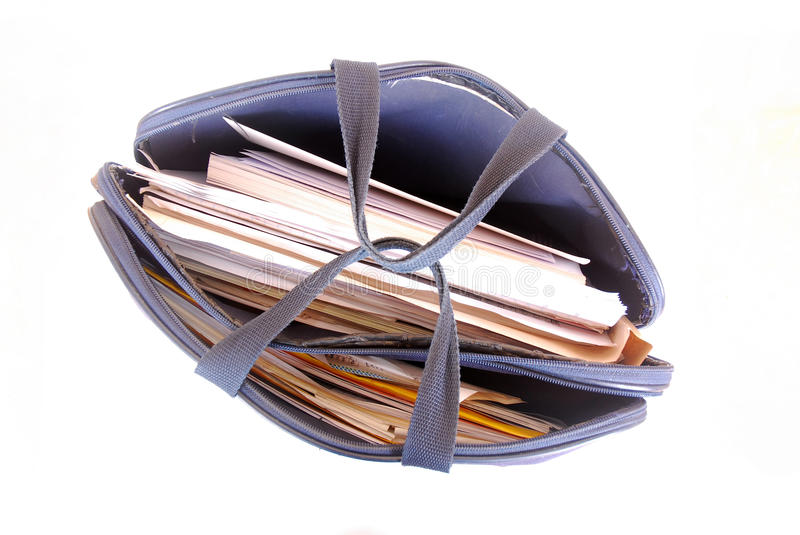 Briefcase full of paper work stock photos