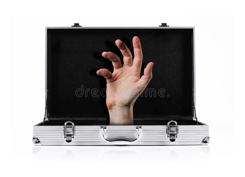 Briefcase hand. Hand appearing from inside a metal briefcase royalty free stock image