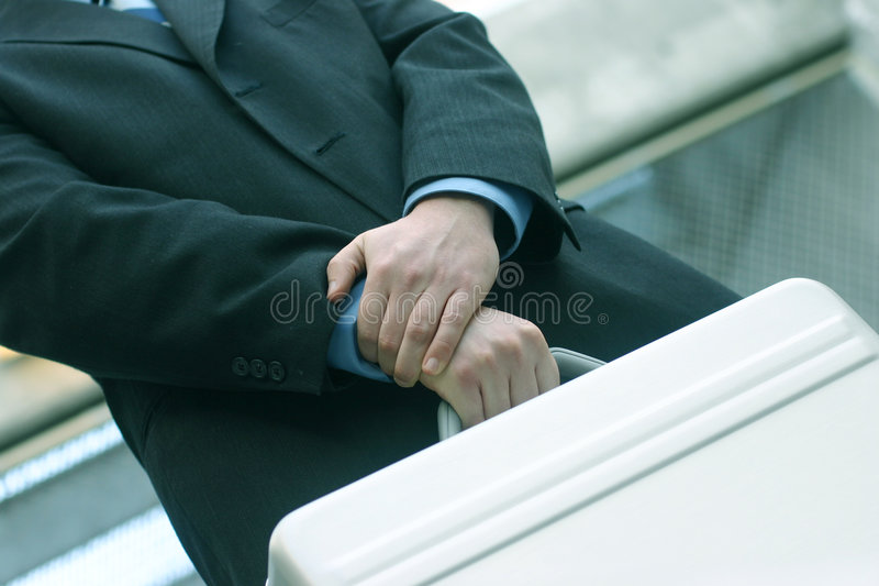 Briefcase in hand stock images