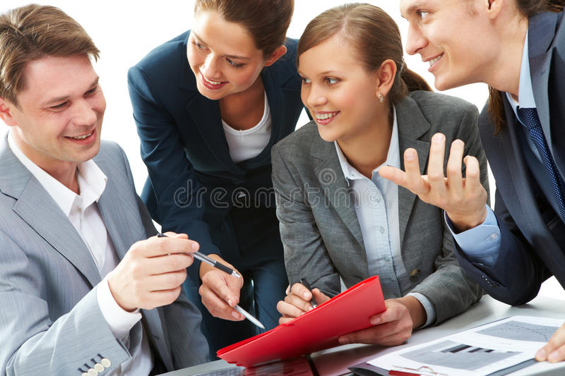 Briefing. Photo of business partners showing document to their boss at meeting stock photo