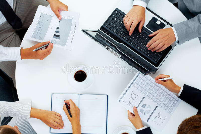 Briefing. Above view of several business people working at meeting royalty free stock images