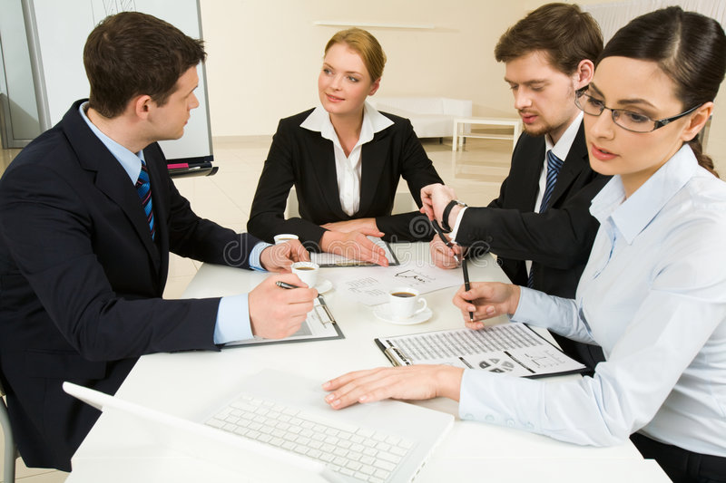 Briefing. Portrait of confident business partners interacting and working at meeting royalty free stock images