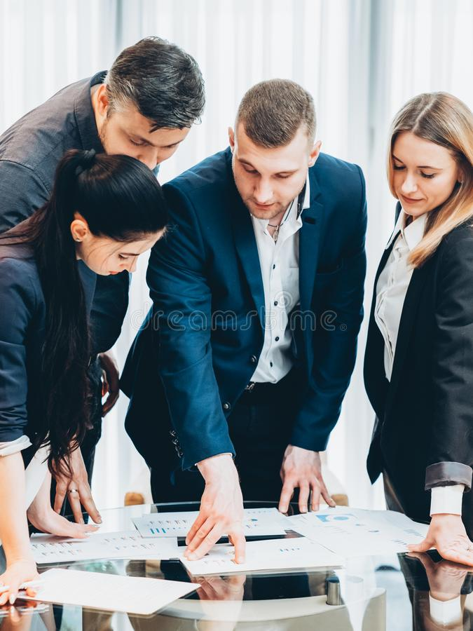 Briefing project manager instructions team meeting. Briefing, brainstorming. Project manager giving instructions to professional team at corporate meeting royalty free stock image