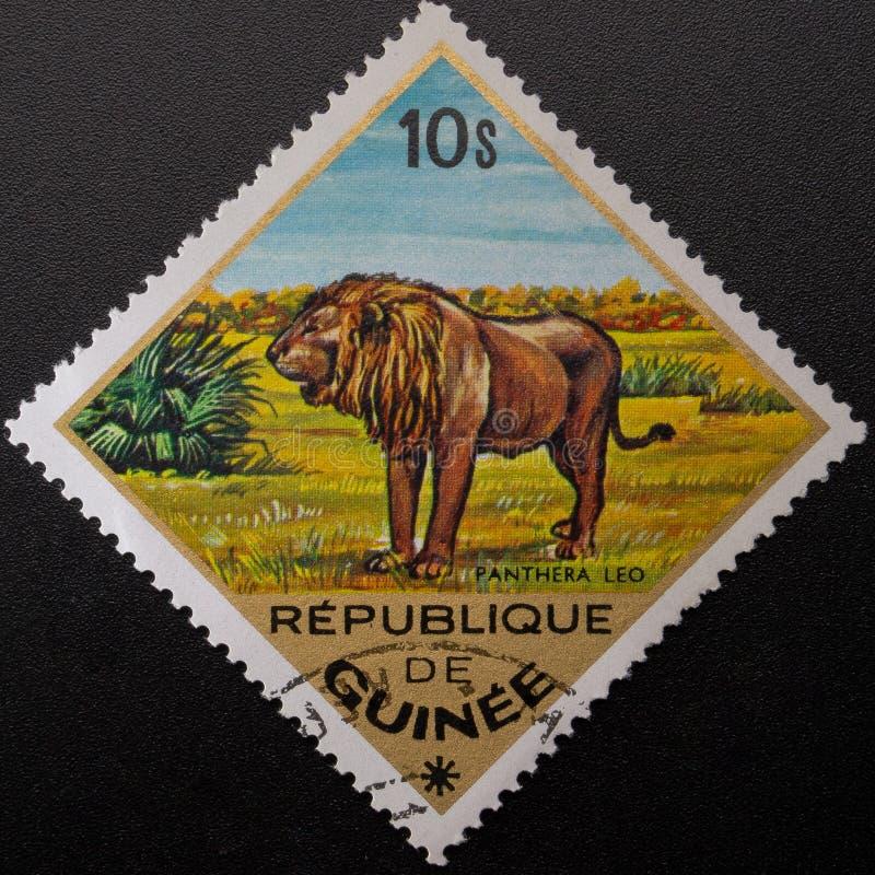 Briefmarke 1975 Republik Guinea Wilde Tiere stockfotos