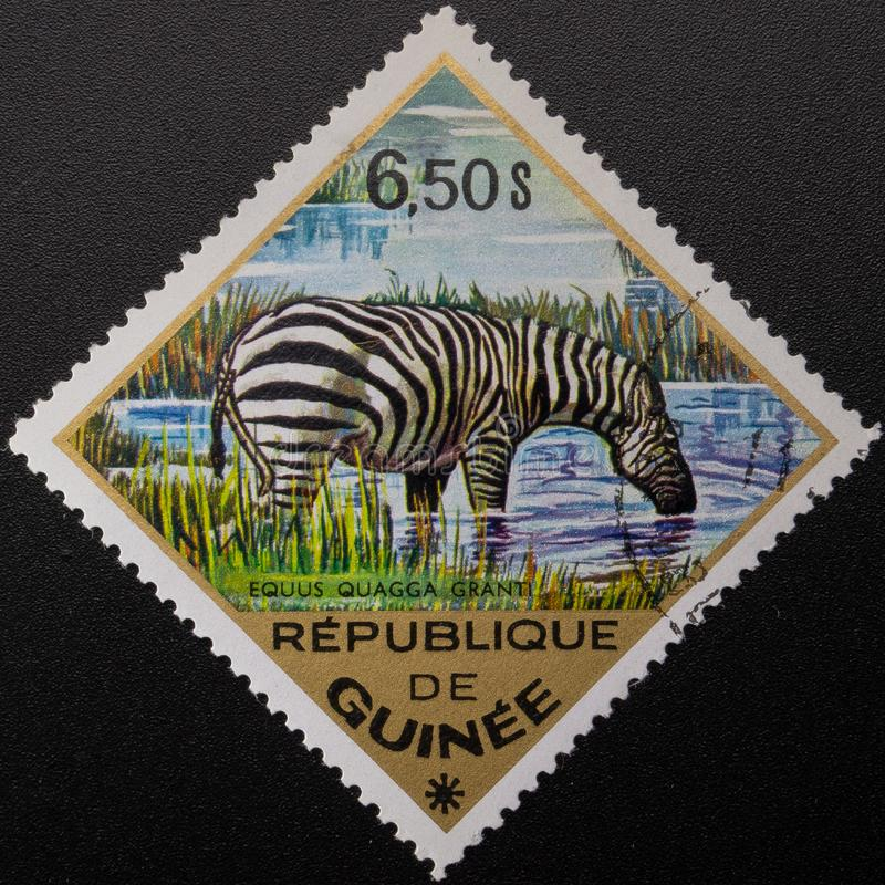 Briefmarke 1975 Republik Guinea Wilde Tiere lizenzfreie stockbilder