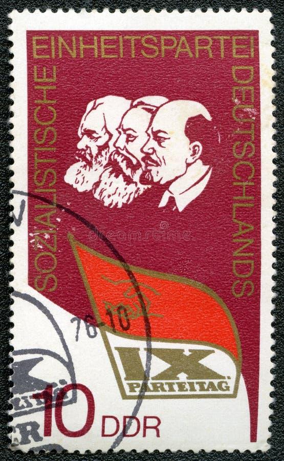Briefmarke zeigt Lenin, Marx, Engels stockfotos