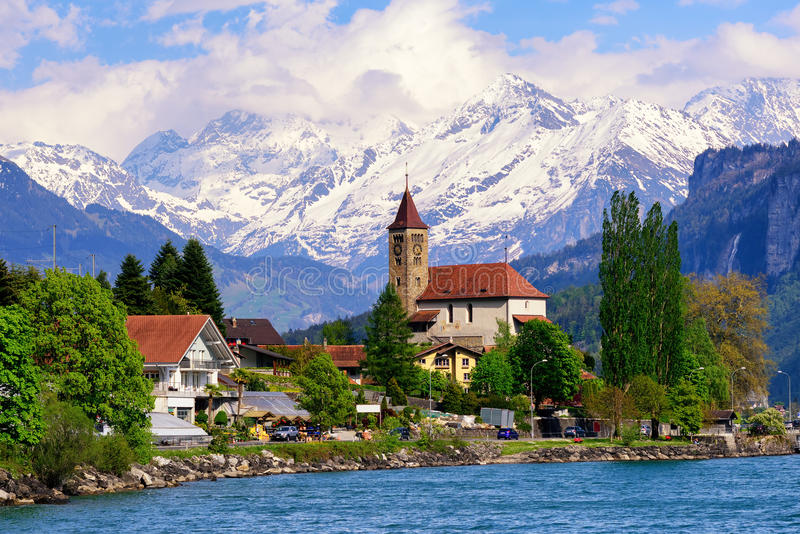Brienz town near Interlaken and snow covered Alps mountains, Switzerland. Brienz town on Lake Brienz by Interlaken, Switzerland, with snow covered Alps mountains stock images