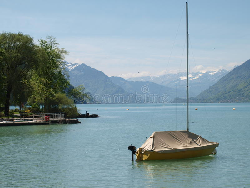Brienzersee lake scenery ,Switzerland. Peacefull landscape on Brienz,with boat on foreground and mountains on infinity view stock photography