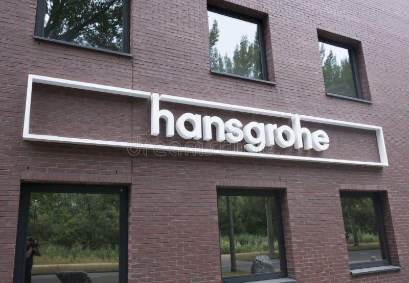 Brieven Hans Grohe op een Muur in Amsterdam stock fotografie
