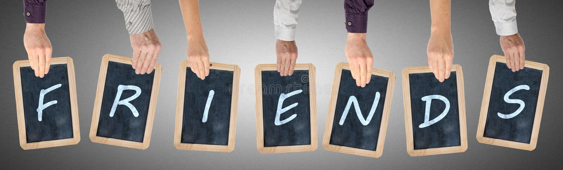 Brieven van de woordvrienden op borden worden geschreven dat stock afbeelding