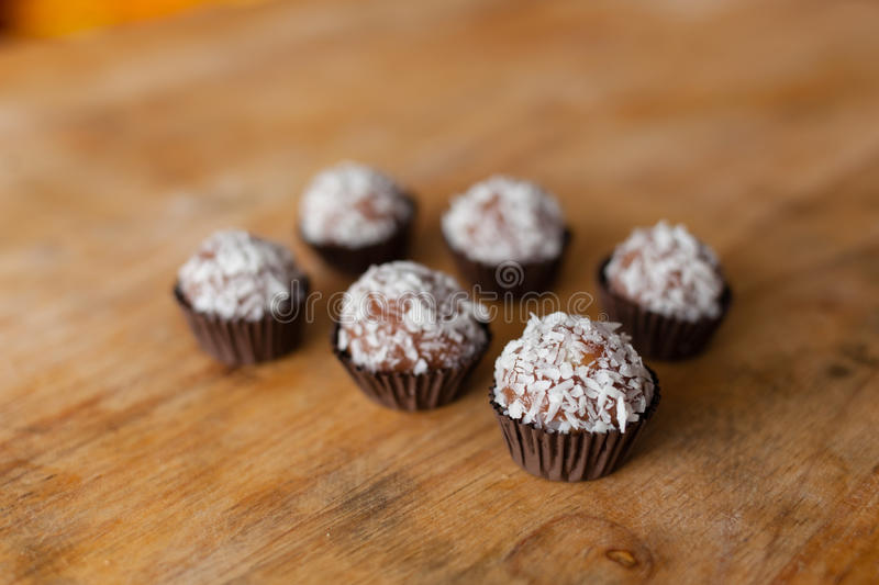 Brigadeiro (brazilian candy). Brigadeiro is a simple Brazilian chocolate bonbon, created in the 1940s. This version is covered with granulated coconut stock photography