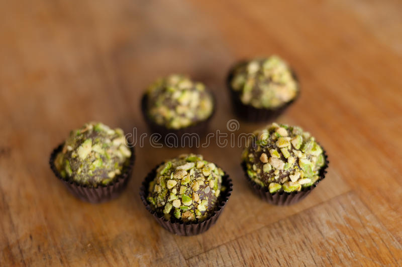 Brigadeiro (brazilian candy). Brigadeiro is a simple Brazilian chocolate bonbon, created in the 1940s. This version is covered with pistachio stock image
