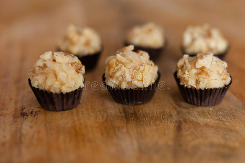 Brigadeiro (brazilian candy). Brigadeiro is a simple Brazilian chocolate bonbon, created in the 1940s. This version is covered with walnut royalty free stock images