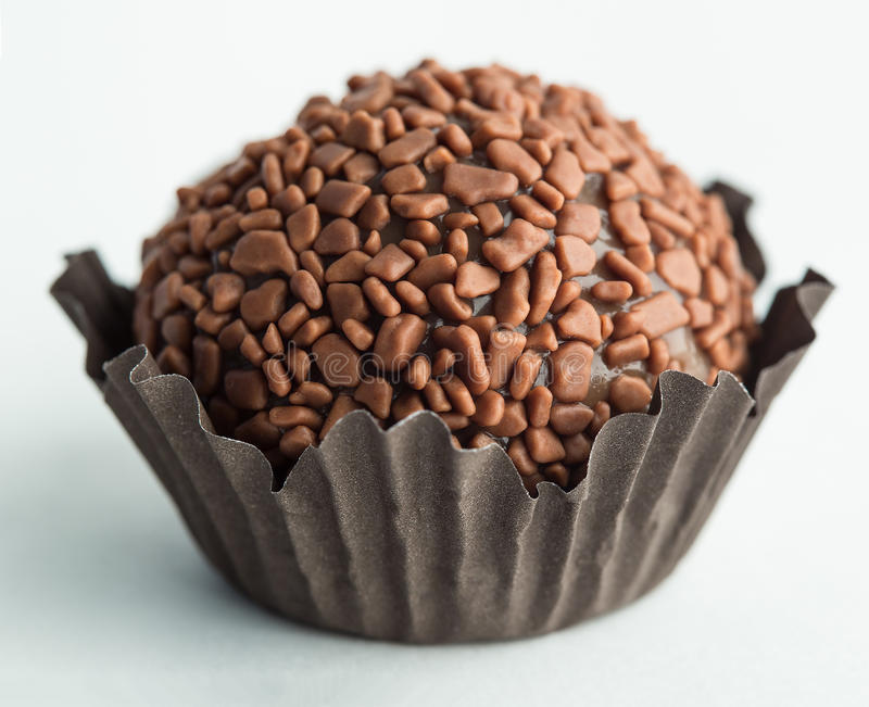 Brigadeiro. (or brigadier), a brazilian chocolate sweet, in a white background with shallow depth of field. Commonly used in children birthdays stock image