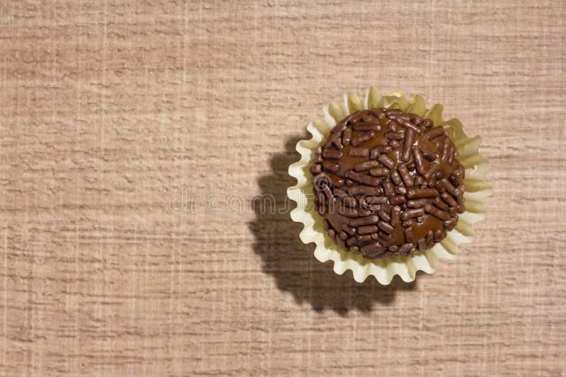 Brigadeiro is a chocolate truffle from Brazil. Cocoa and sprinkles of chocolate. Children birthday party sweet. Flat lay design o. Brigadeiro is a typical royalty free stock photography