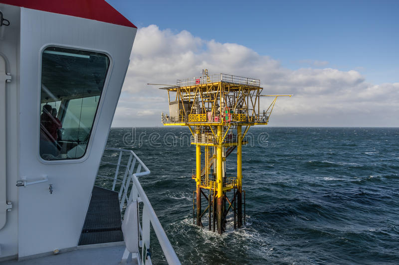 Brigantine BG unmanned gas platform view from an attending ships stock images