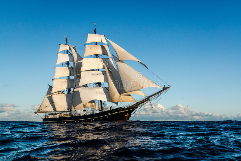 A brigg on the atlantic with all sails aloft. Traditional sailing vessel Roald Amundsen with all sails aloft on its way across the Atlantic ocean. The brigg has royalty free stock photography