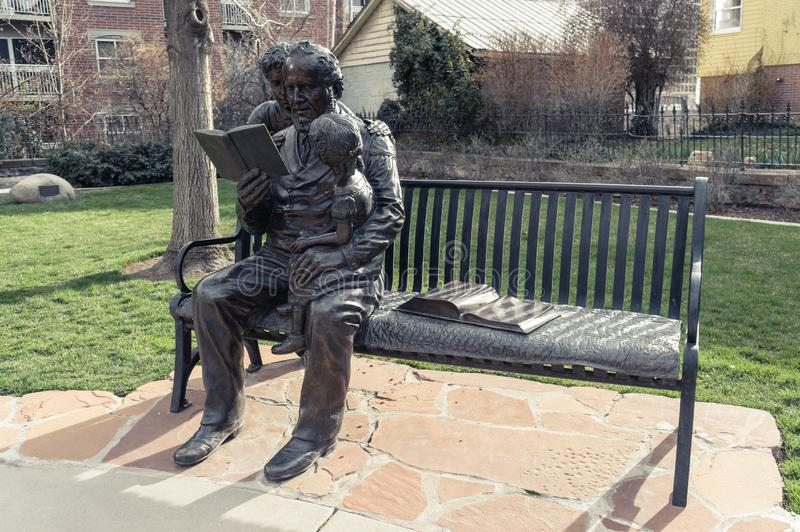 Brigham Young en zijn jonge geitjesstandbeeld, bij Mormoons Pioniersgedenkteken, D royalty-vrije stock foto's