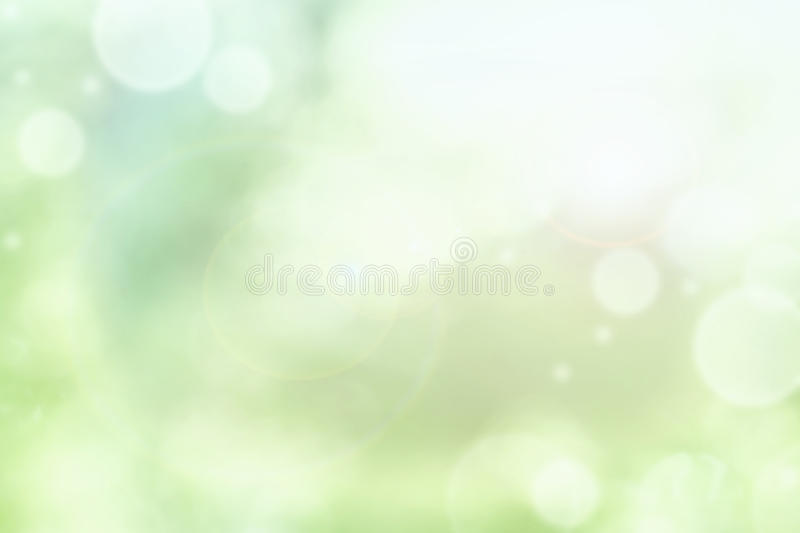 Bright Abstract of Blurred Green Summer Bokeh. Bright abstract background of blurred circular green bokeh circles for summer backgrounds stock photos