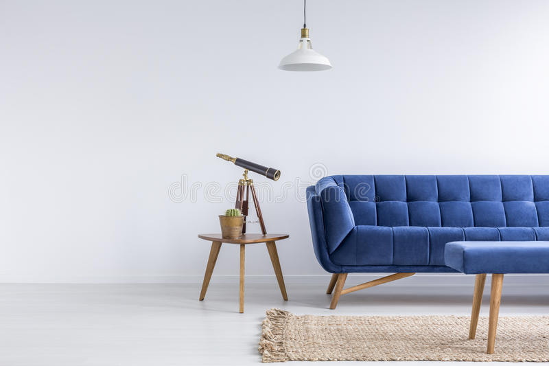 Bright apartment with blue sofa stock photo