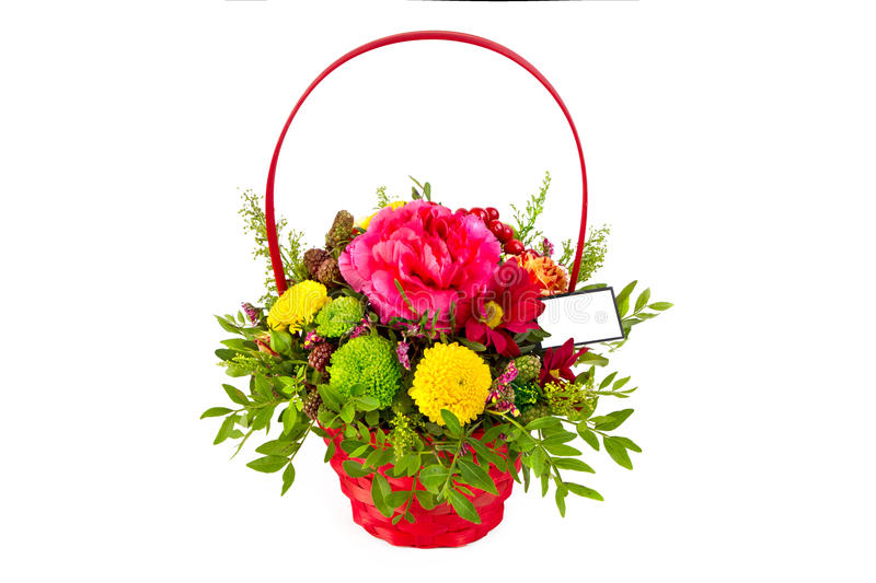 Bright arrangement of flowers in basket, isolated background stock photo