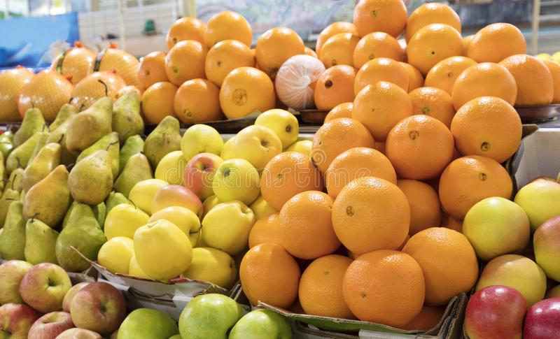 Oranges, apples, pears lie on the market counter for sale royalty free stock photos
