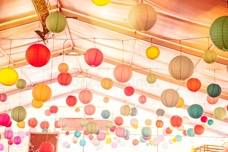 Bright background with many colorful chinese round lantern decorating the ceiling of hall at celebrating event, festival, party. P royalty free stock image