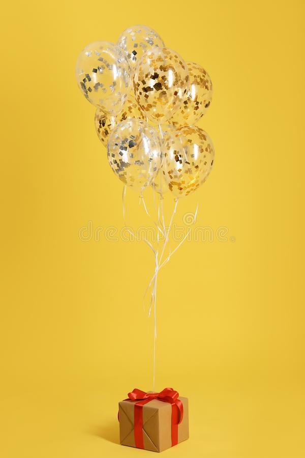 Bright balloons and gift box royalty free stock images