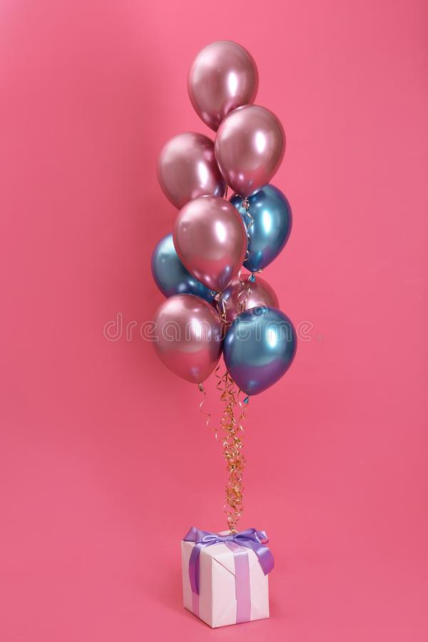 Bright balloons and gift box royalty free stock photos