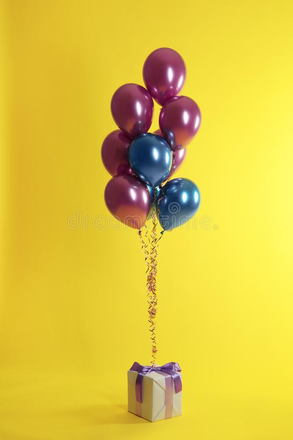 Bright balloons and gift box stock photos
