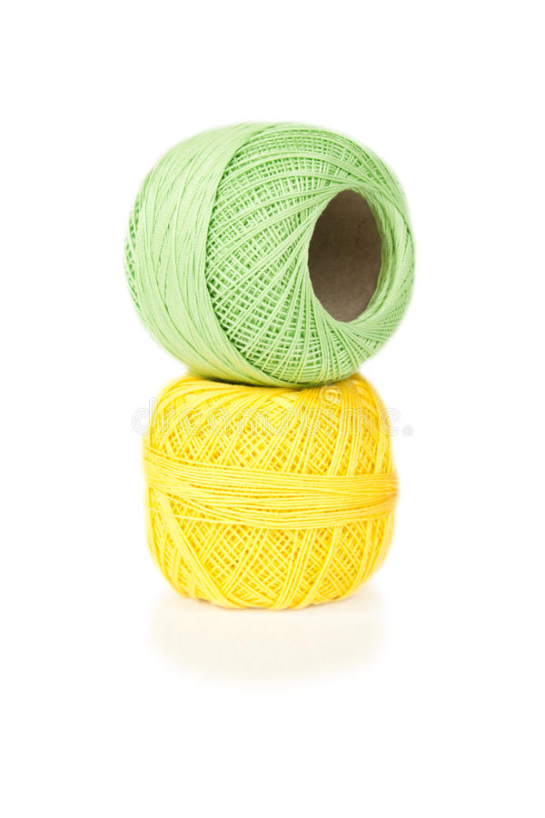 Bright balls of yarn on white stock images