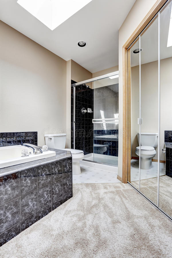 Bright Bathroom Interior With Black Granite Tile Trim