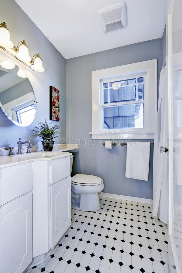 Bright bathroom interior in light blue color stock image