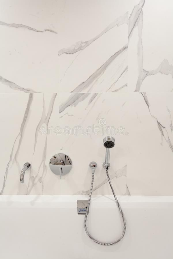 Bright bathroom with new tiles. Chrome shower, faucet, white bathroom. Bright bathroom with new tiles. Chrome shower, faucet, white bathroom stock photos