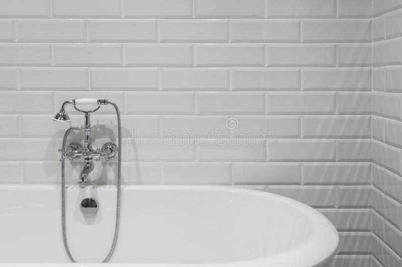 Bright bathroom with new tiles. Chrome shower, faucet, white bathroom. Bright bathroom with new tiles. Chrome shower, faucet, white bathroom royalty free stock photos