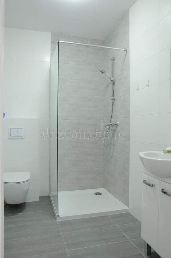 Bright bathroom with shower stock images