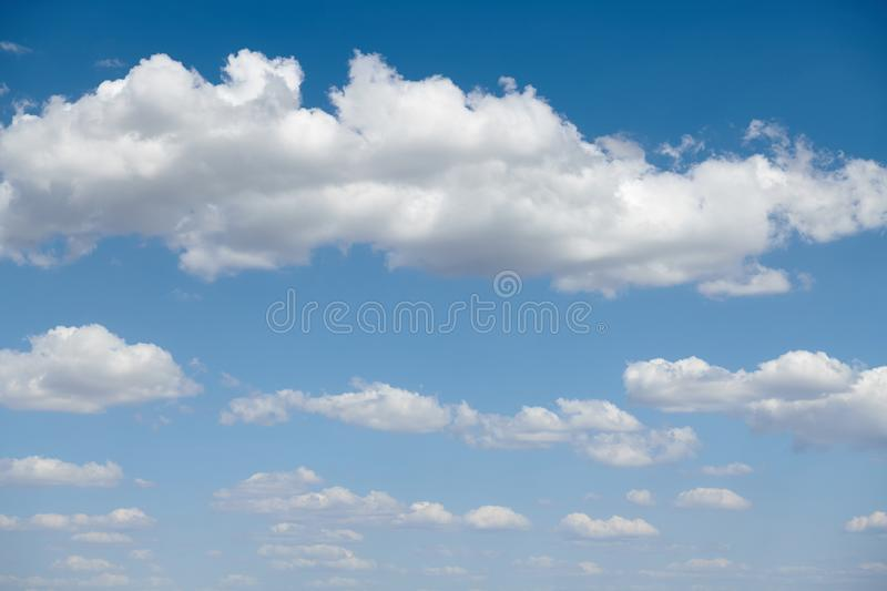 Bright beautiful blue sky with clouds for background or texture royalty free stock photography