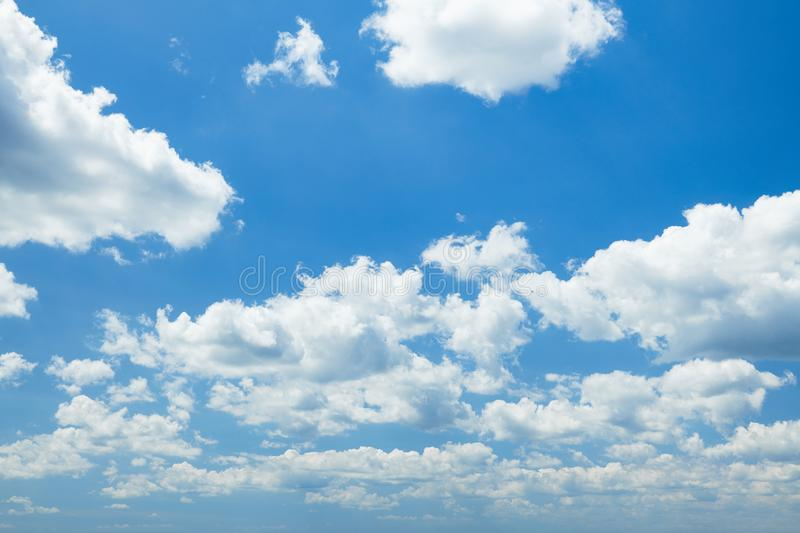 Bright beautiful blue sky with clouds for background or texture royalty free stock photo