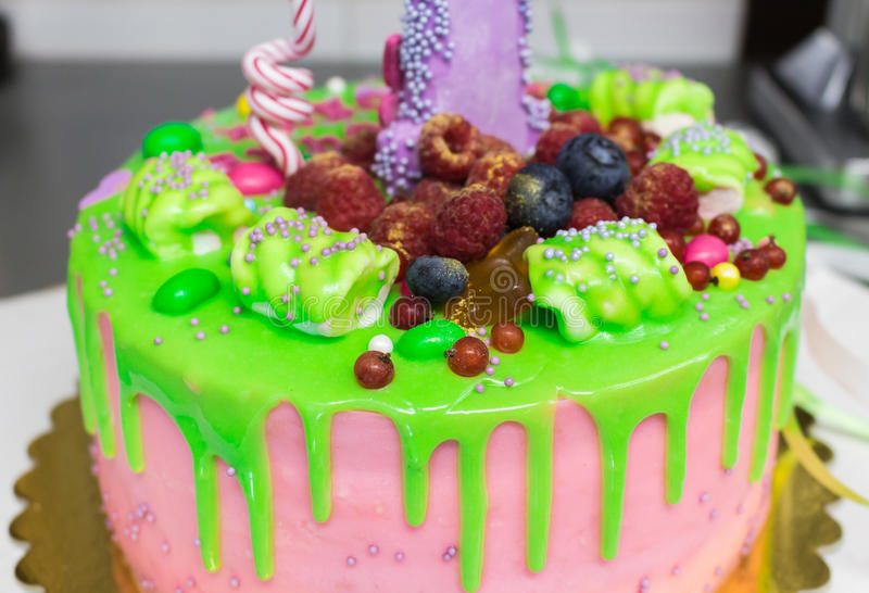 Bright and beautiful cake with berries in the glaze royalty free stock photo