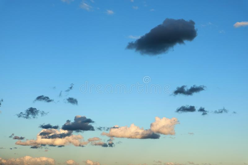 Bright beautiful clear sky with colorful clouds in bloom as the background stock photos