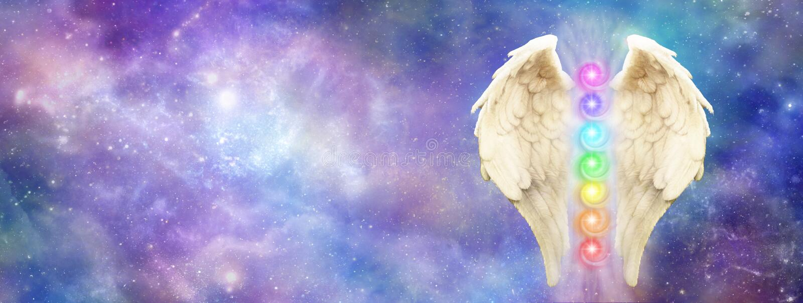 Angelic Cosmic Guardian Website Banner. Bright and beautiful cosmos background with a pair of Angel Wings and seven chakras royalty free stock photo
