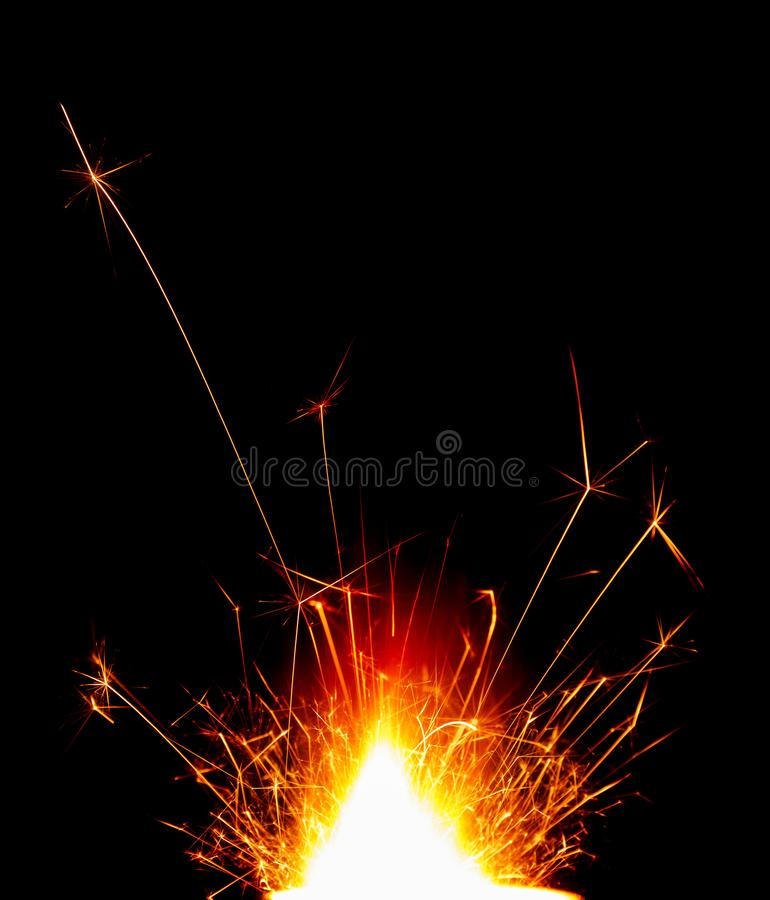 Bright beautiful holiday Sparkler isolated on black royalty free stock images