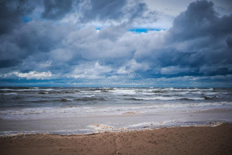 Bright beautiful landscape, cold Baltic sea during a storm, harsh northern nature royalty free stock image
