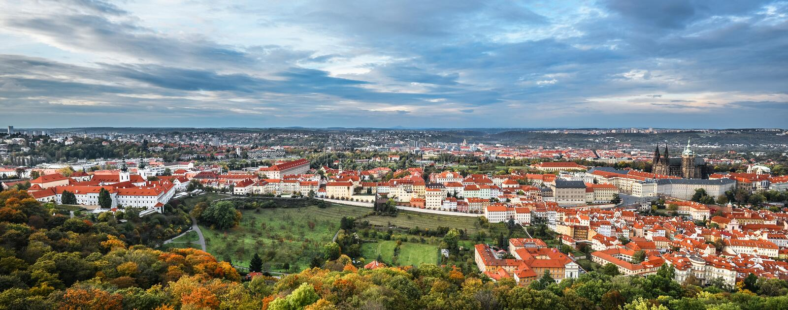 Bright and beautiful panoramic view on Saints Vitus Cathedral, Prague Castle, Old town and city center with old red roofs and dram royalty free stock photos