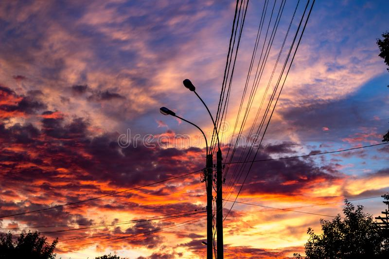 Bright beautiful sunset on the background of power lines stock photography